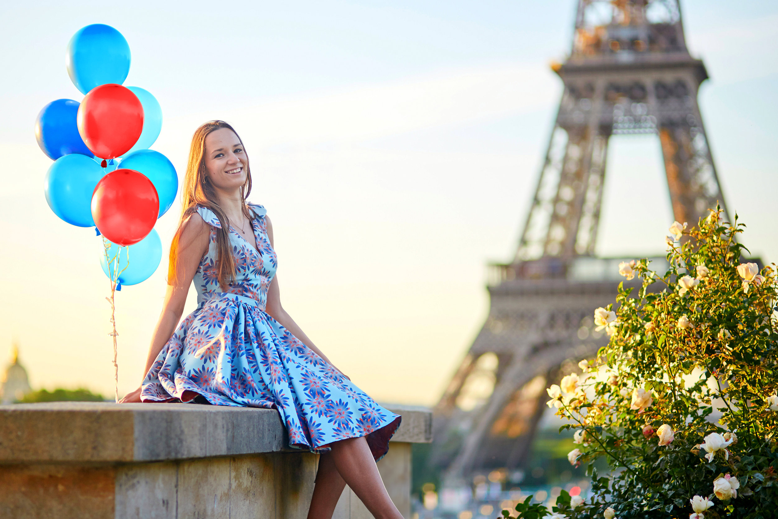 Happy young couple portrait by Eiffel Tower Paris and balloons retouching