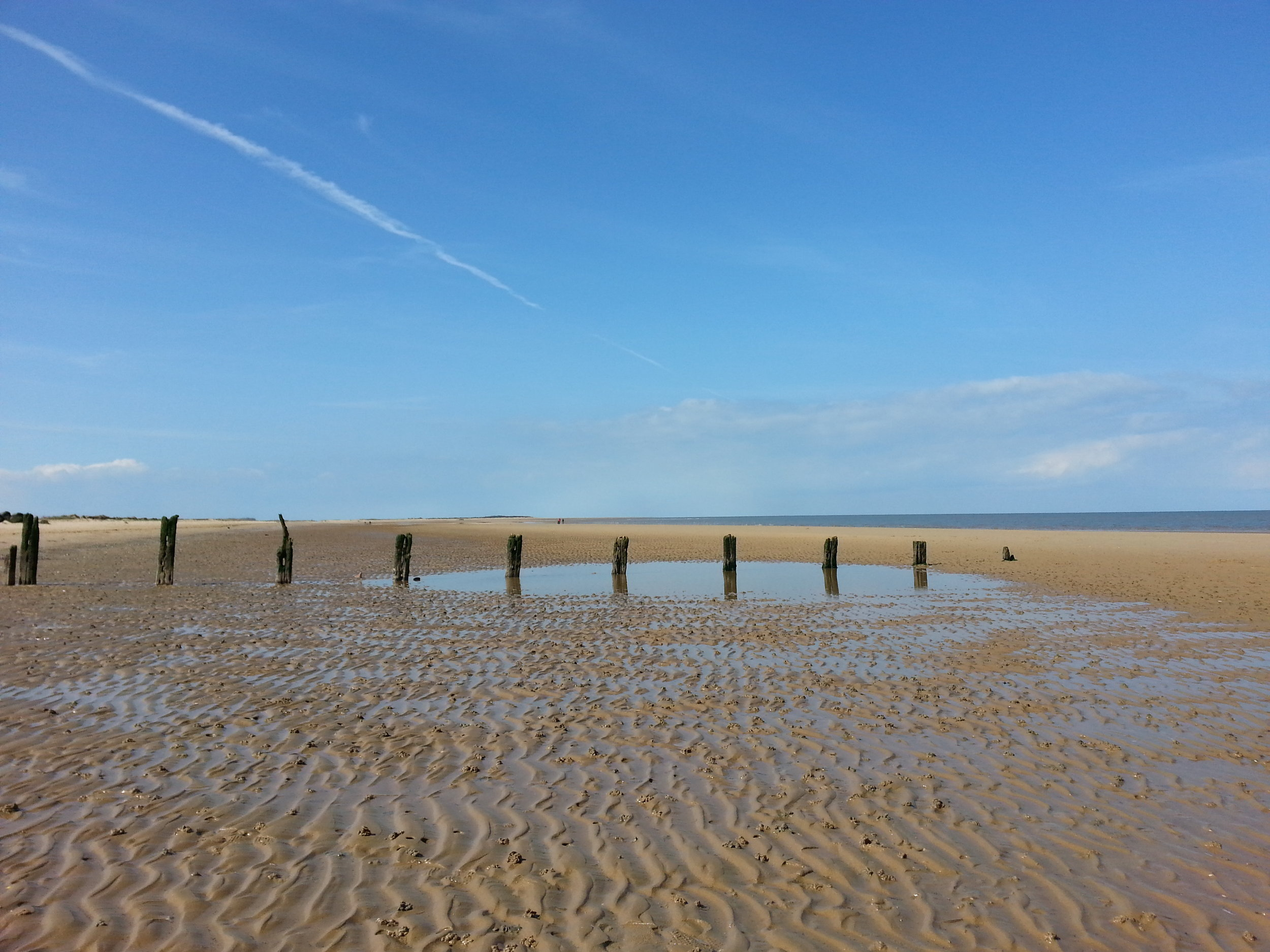 Brancaster - Brancaster beach is yet another of Norfolk's glorious beaches, with miles and miles of unspoilt golden sand, as far as the eye can see, and also has the added advantage of housing the remains of an old shipwreck, seen when the tide is out.