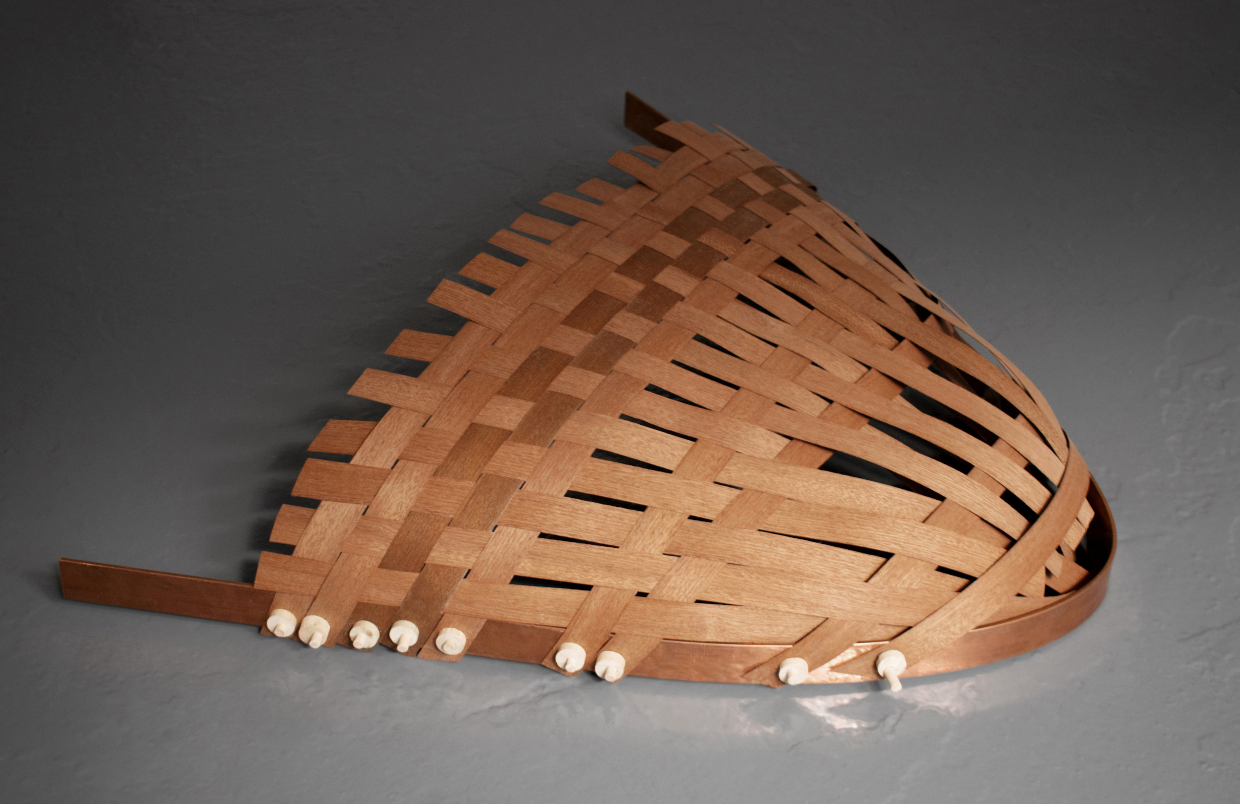 Bring me to The River and I will Follow  Weaved Sapele veneer on bent copper and wooden clamps. 63 x 56 x 10 cm. 2019