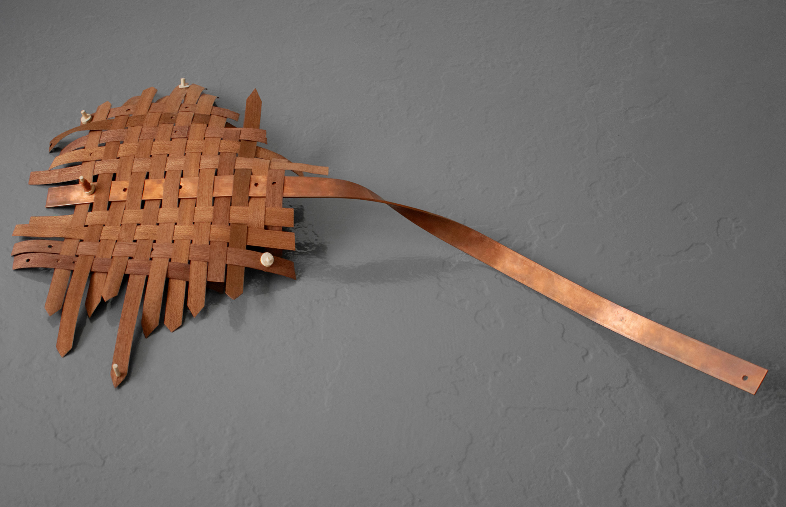 Blow to me, The Air I breathe  Weaved Sapele veneer, bent copper, wooden clamps. 35 x 60 cm. 2019