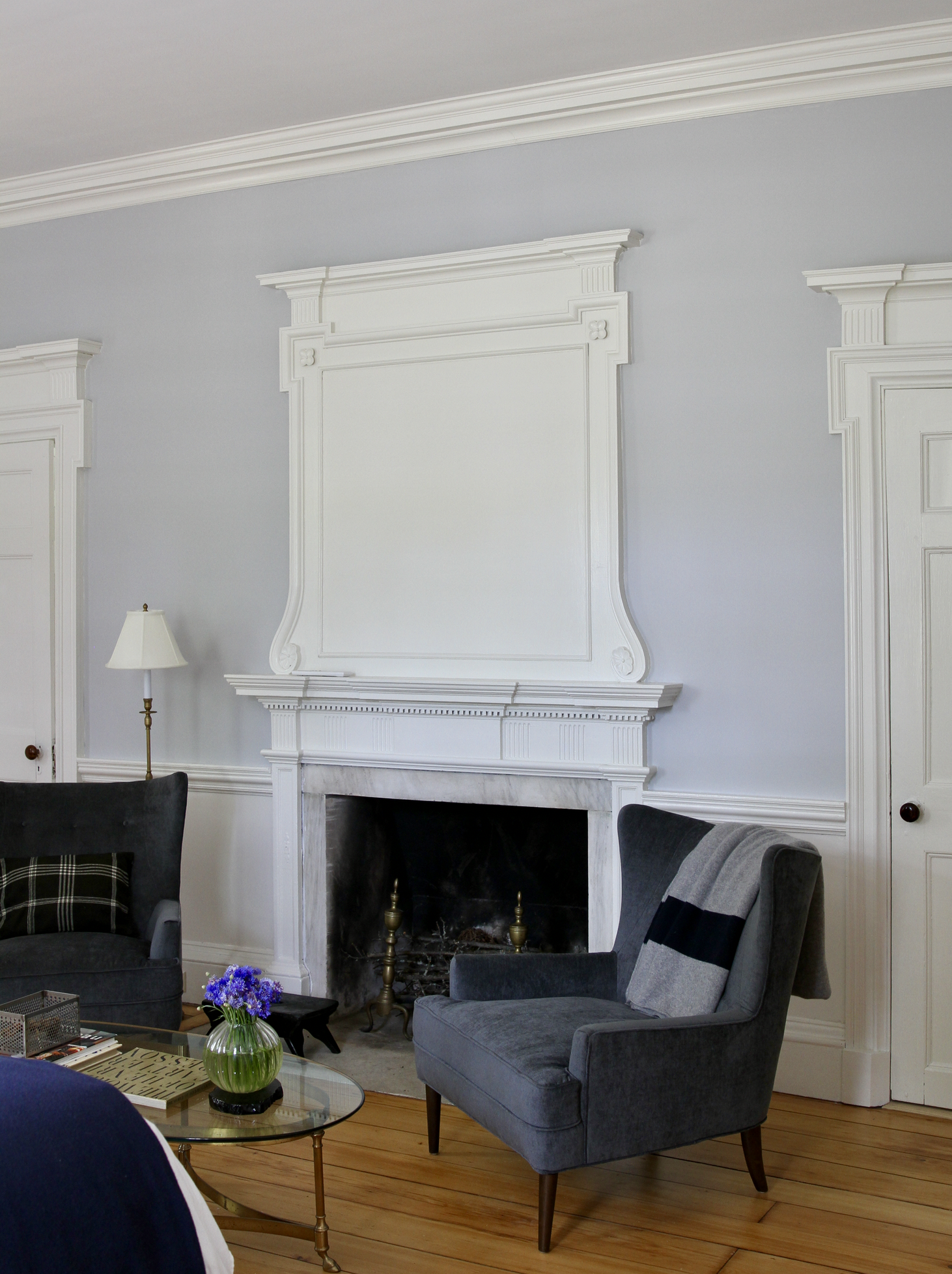 Room One   Of the nine fireplaces at Kenmore Hall, the most impressive may well be in room one, with an original overmantel panel featuring exquisitely detailed hand carved woodwork. Comfortable armchairs for reading.