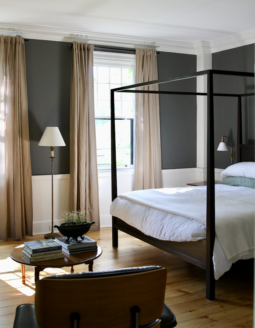 Room Three   Classical moldings and period details are offset by charcoal walls. A king sized four poster bed features   Matteo Linens  , a down comforter, and blanket from   Faribault Woolen Mill  . Bedside lamps commissioned from   Clark Vintage Lighting.