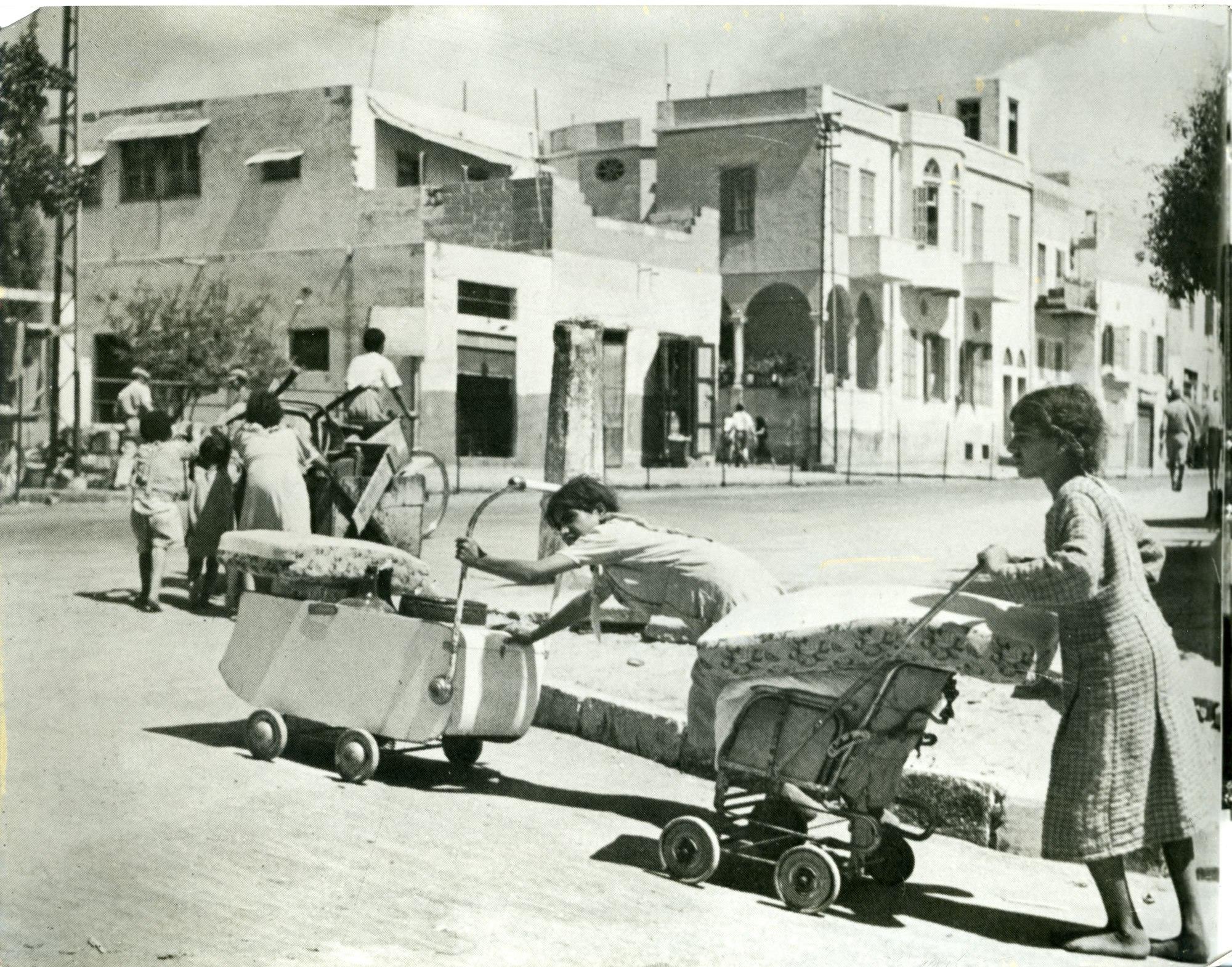 Palestinians fleeing Jaffa with their belongings, 1948.  [1]