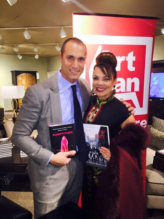 Donna Yost trading Books with Nigel Barker