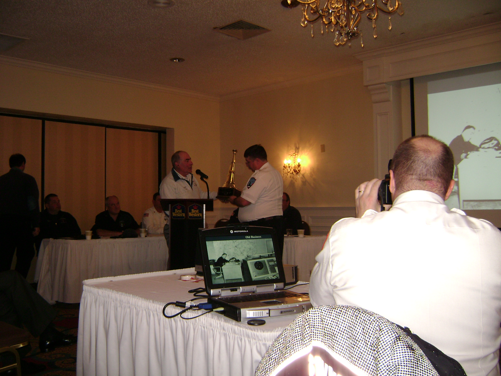 Chief Tirrell receiving 25 years of service award from President Harry Boynton 2011