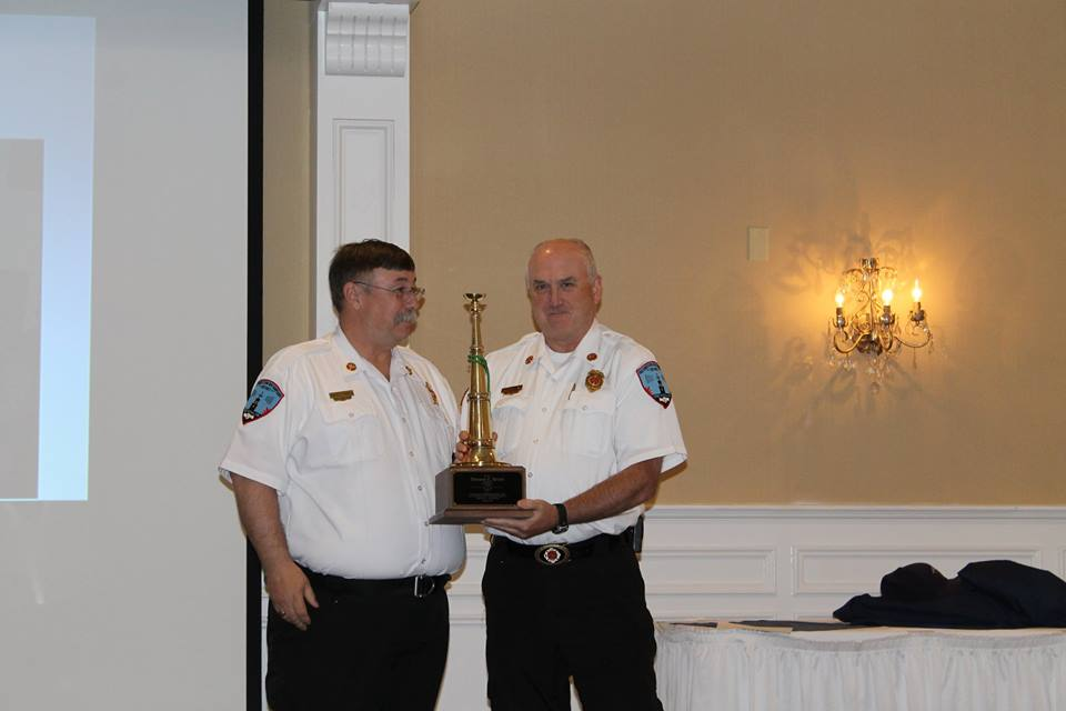 Deputy Chief Tom Redin receiving 25 years of service award in 2017.