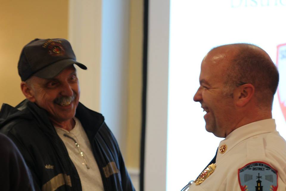 Retired Dispatcher Walt Kesek talks to Deputy (soon to be Chief) Sangermano before the meeting. 2018