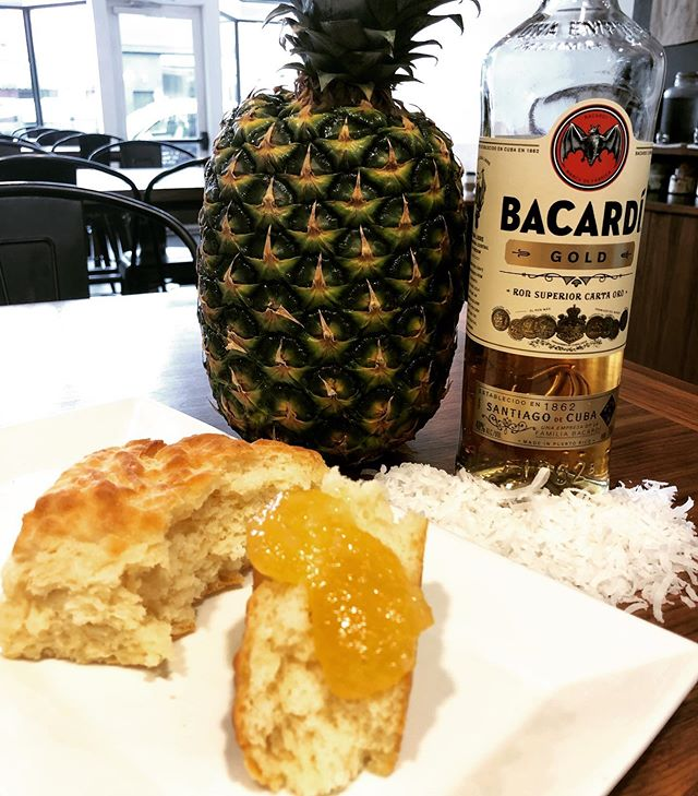 """Continuing our """"summer cocktail"""" jam series, we decided to make a Piña Colada Jam! We started with fresh pineapples and shredded coconut, then finished it with a little @Bacardi Gold! A bite of this jam might just be all the motivation you need to ditch work and head to the beach! The only thing we don't have for this jam are tiny umbrellas.... . . #biscuit #biscuits #allbutter #allthetime #pinacolada #rva #richmond #rvadine #madefromscratch"""