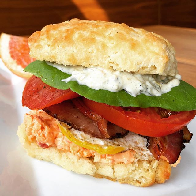 """What could make our Hanover Tomato BLT even better? How about putting it on a biscuit and adding an egg? Done and done! Starting today we are serving a breakfast/brunch version of our BLT! Still with delicious Bangin' Pimiento Cheese from @soulnvinegar, local Hanover Tomatoes, thick-cut bacon & charred jalapeño mayo that you love, but now constructed as more of a """"fork and knife"""" kind of dish! . . . #bltsandwich #blt #biscuit #biscuits #allbutter #allthetime #breakfast #brunch #rva #richmond #rvadine"""