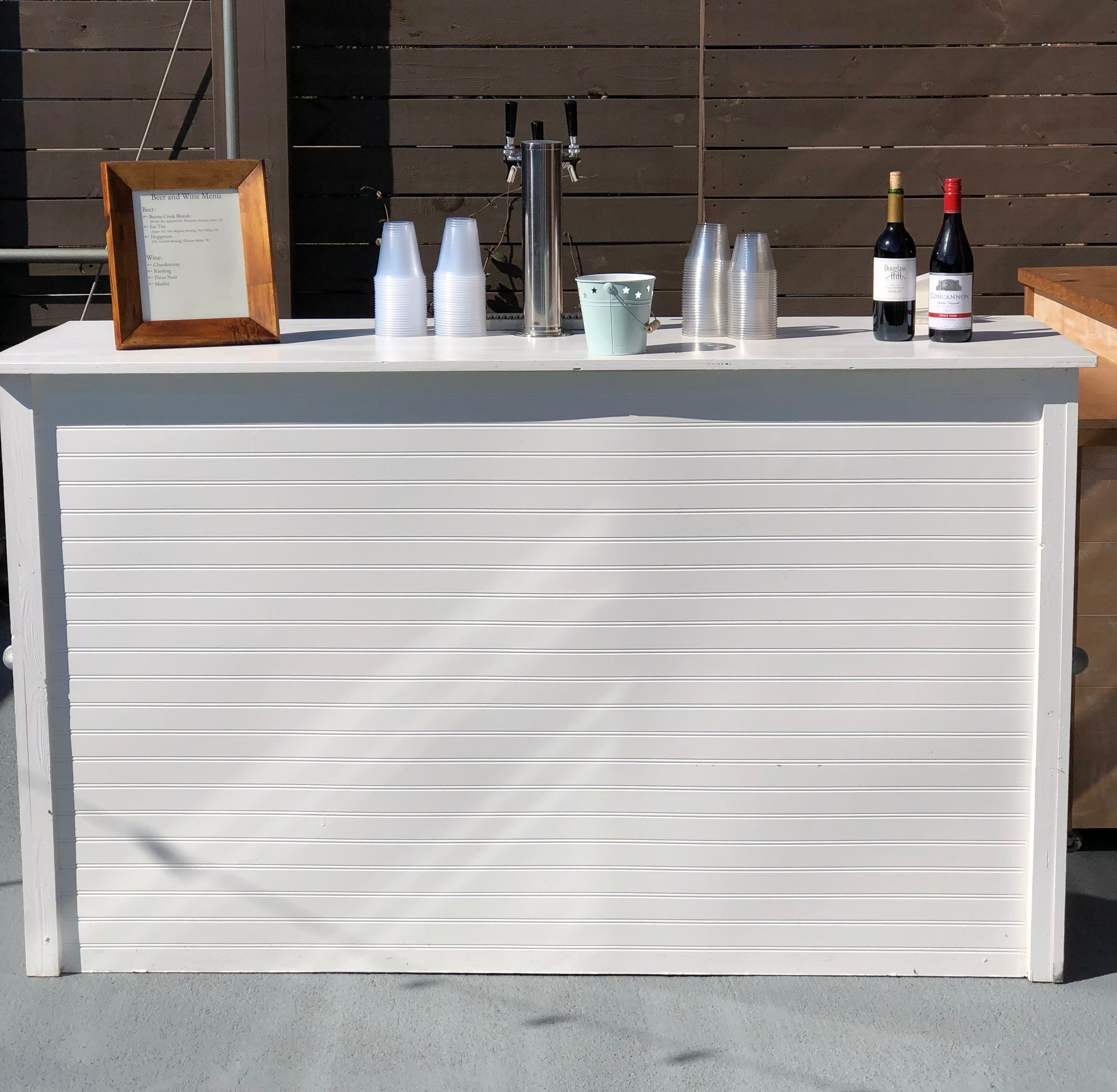 White Draft Bar - This stylish three-tap white wooden bar is the perfect addition for indoor receptions and is included with any alcohol package.