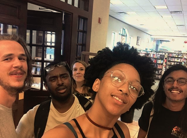 group selfie in front of the Barnes & Nobles entrance where members of our group were profiled up on entering. Not long after our discussion on text by Kimberlé Krenshaw... n Butler started, constituents proposed to switch locations, since Barnes and nobles was no longer a safe space.