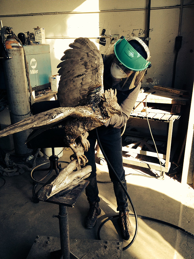 Vicki hard at work on one of her two harpy eagle sculptures