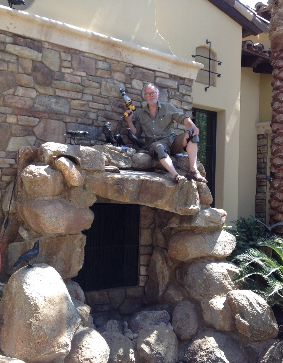 FLOCK OF CROWS - Vicki's husband Paul Shardlow shows off a job well done, post-installation of this commission: a flock of bronze crows adorning a customer's waterfall.