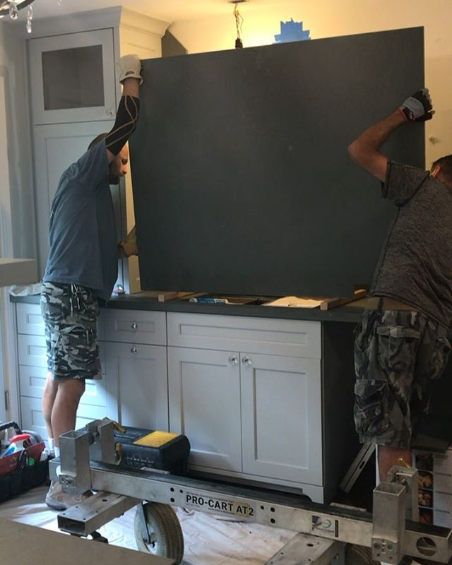 Nearing the end: the hardest kitchen to design is my own!  Only the best crew can mount a heavy stone slab and take a call at the same time!  #stoneslabs #installation #kitchenrenovation #interiordesign #chicagodesigner #wilmettedesigner #DebIDGroup