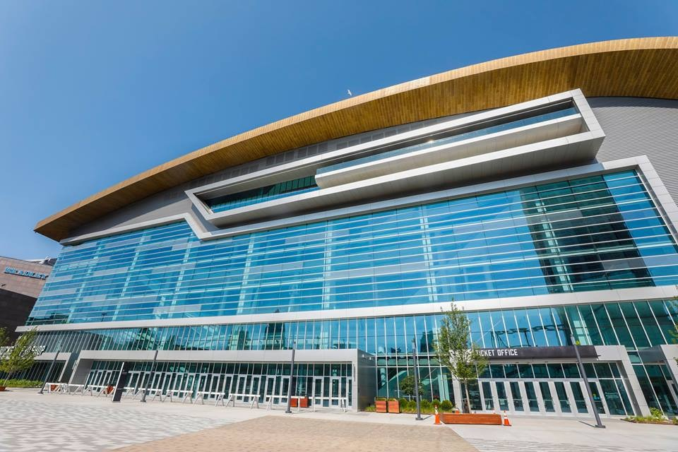 Street view of the Fiserv Forum on a sunny day.