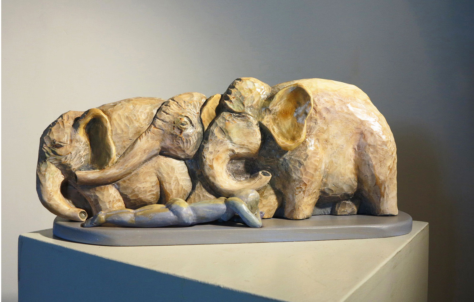 "Dreaming Elephants carved and painted wood 9"" x 21"" x 5""   Inquire >"