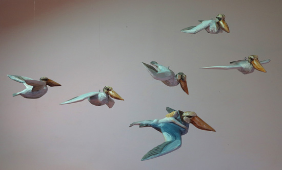 Pelicans in flight, 2015 carved and painted basswood varying sizes