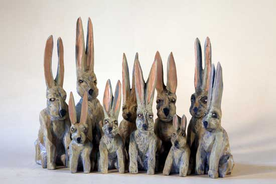 "Group of Rabbits, 2009 carved and painted wood with moonstone eyes sizes vary from 4""- 9"" tall"