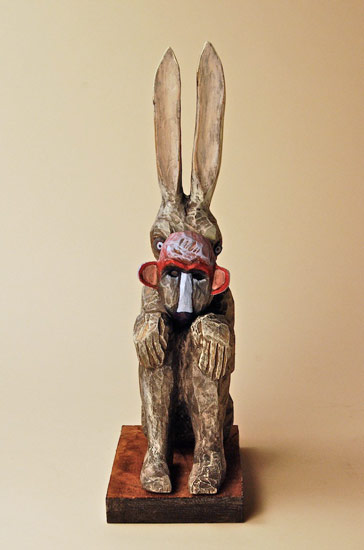 "Trickster, 2009 carved and painted wood 14""x 4""x 6"""