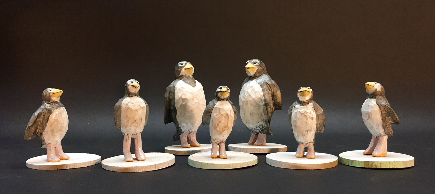"Penguin Lineup carved and painted wood varying sizes 4"" x 2"" x 2"""