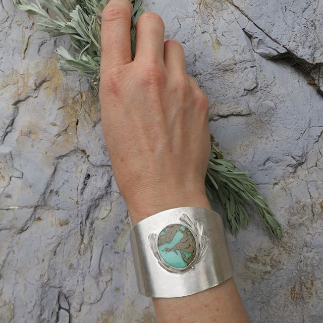 KathleenCarricaburu Mystic Sagebrush Cuff, Sterling Silver and Royston Turquoise,the West is not the West without sagebrush, Native Americans taught us how to use it as herbal medicine and as a smudging herb .The beauty of it's distinct color , endurance and ability to survive the desert climate make it a powerful personal symbol and connection to the land. Made for the Utah Arts Festival come visit us at booth#37 #kathleencarricaburu #UtahArtsFest #naturejewelry #environmentaljewelry #ribbonturquoise #ofthewest #jewelryofutah