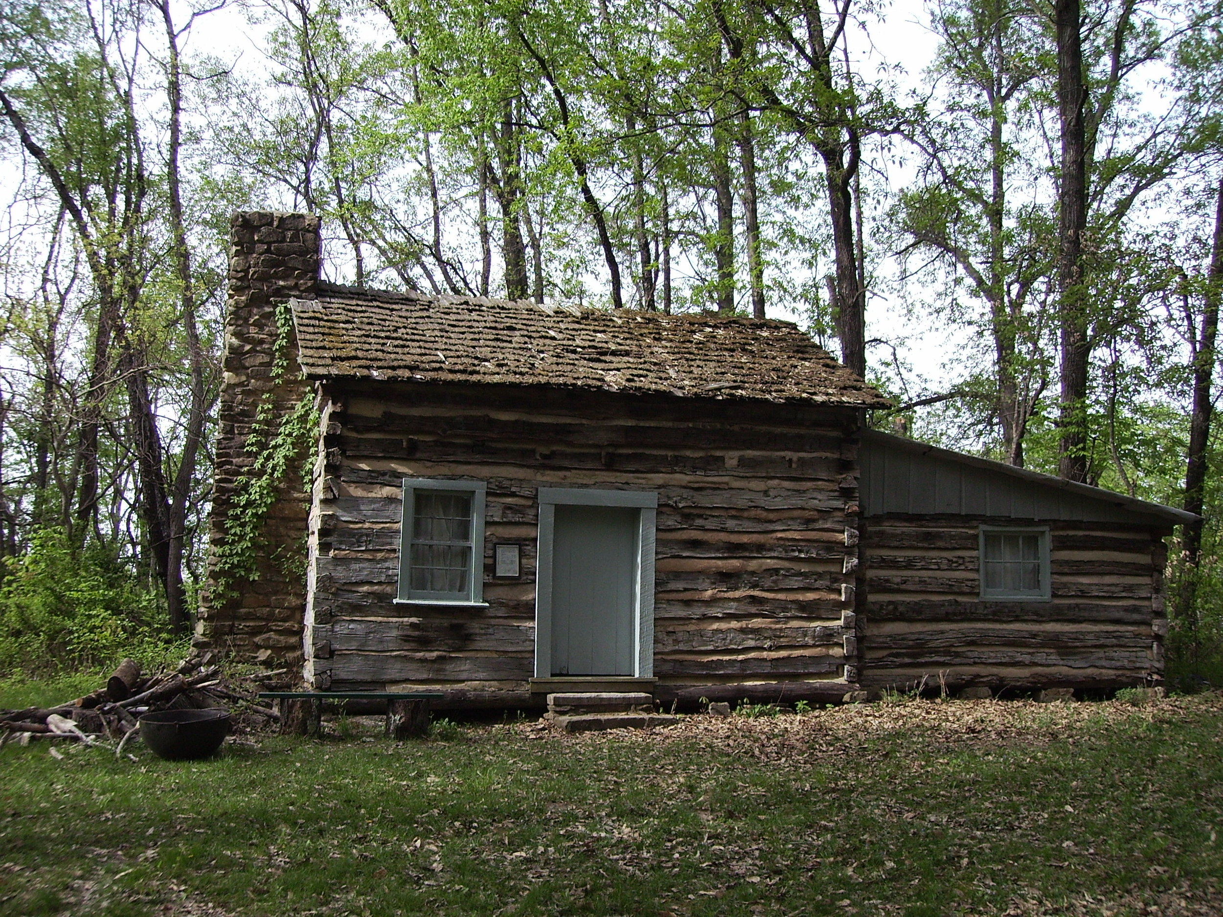 "Doolen Cabin - The Doolen cabin was built about 1860. Benjamin Doolen was born in Foster Township on February 23, 1843 and died March 1, 1926. He married Laura Ann Jones born January 16, 1843 on September 30, 1860. Both Benjamin and Laura were 17 years old. At age eighteen their first child was born, Harriett Llewellyn.At age nineteen Ben enlisted in the Union Army serving in Company D 111th Illinois Infantry from 1862 -1865. His Company was with General Sherman on the famed ""march to the sea"".Benjamin and Laura had three more children: Sherman, born April 1866 died thirteen days old; Icy Dora, born March 1867; and Charles Isham, born August 1869.After the death of Laura, Ben married Mrs. Inis Tate on September 26, 1896.Benjamin is buried in Doolen Cemetery with his two wives."