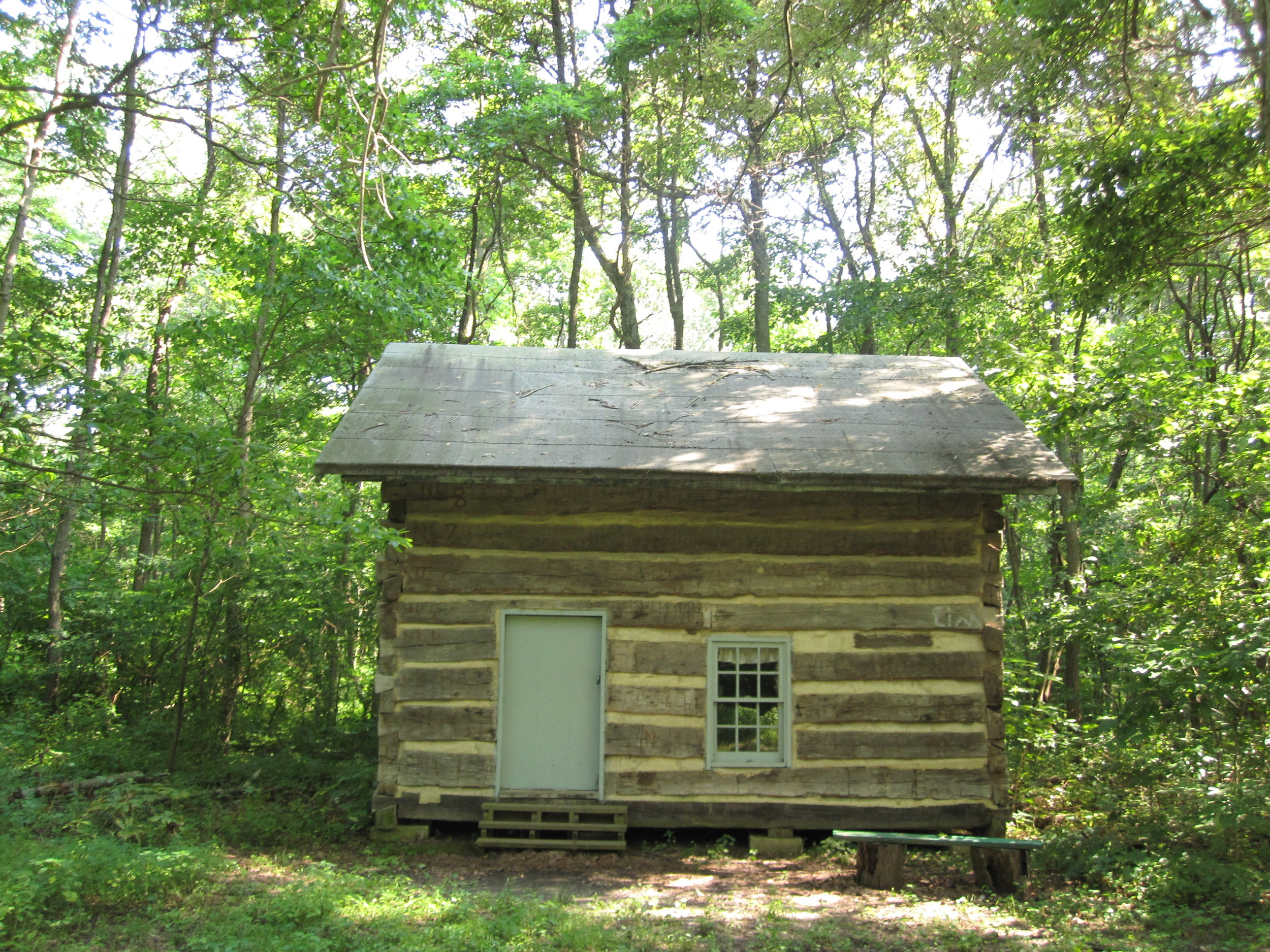 Schwarm Cabin - This cabin was built by John and Barbara Schwarm in the late 1840's. John was born in Lebanon County Pennsylvania on June 15, 1812. He married Barbara in Ohio on October 6, 1842. When they reached Illinois, John purchased land from the U.S. Government for $1.25 an acre. The location the cabin was built on was near Hickory Creek close to the Old Loogootee Cemetery just north of Route 185 at the top of a hill.When John and Barbara settled in the area there were no church buildings, so from 1849 to December 1852 they invited their neighbors of like mind to worship with them in their home.