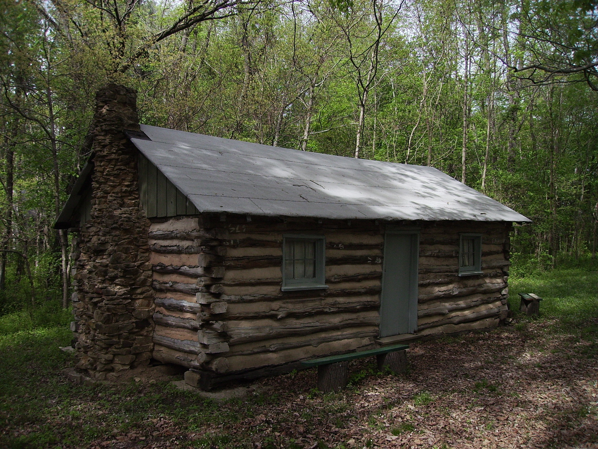 Preacher/Wagoner Cabin - The preacher's cabin was located near Forbes Lake. It was built for a circuit rider of the Methodist faith. The second preacher was a Wagoner. He also ran a sorghum mill. Preacher Wagoner added a leanto for a kitchen but this addition was not replaced since it was not part of the original cabin. The third preacher was Reverend Miller.Russell Wagoner moved into this home with his father, mother and older brother as a small child of two years in 1939. Russell, nicknamed Cotton, lived here a short time. The cabin had belonged to his great grandfather, Steven Jacob WagonerErma Ingram purchased the log cabin when the Forbes Lake was being built.