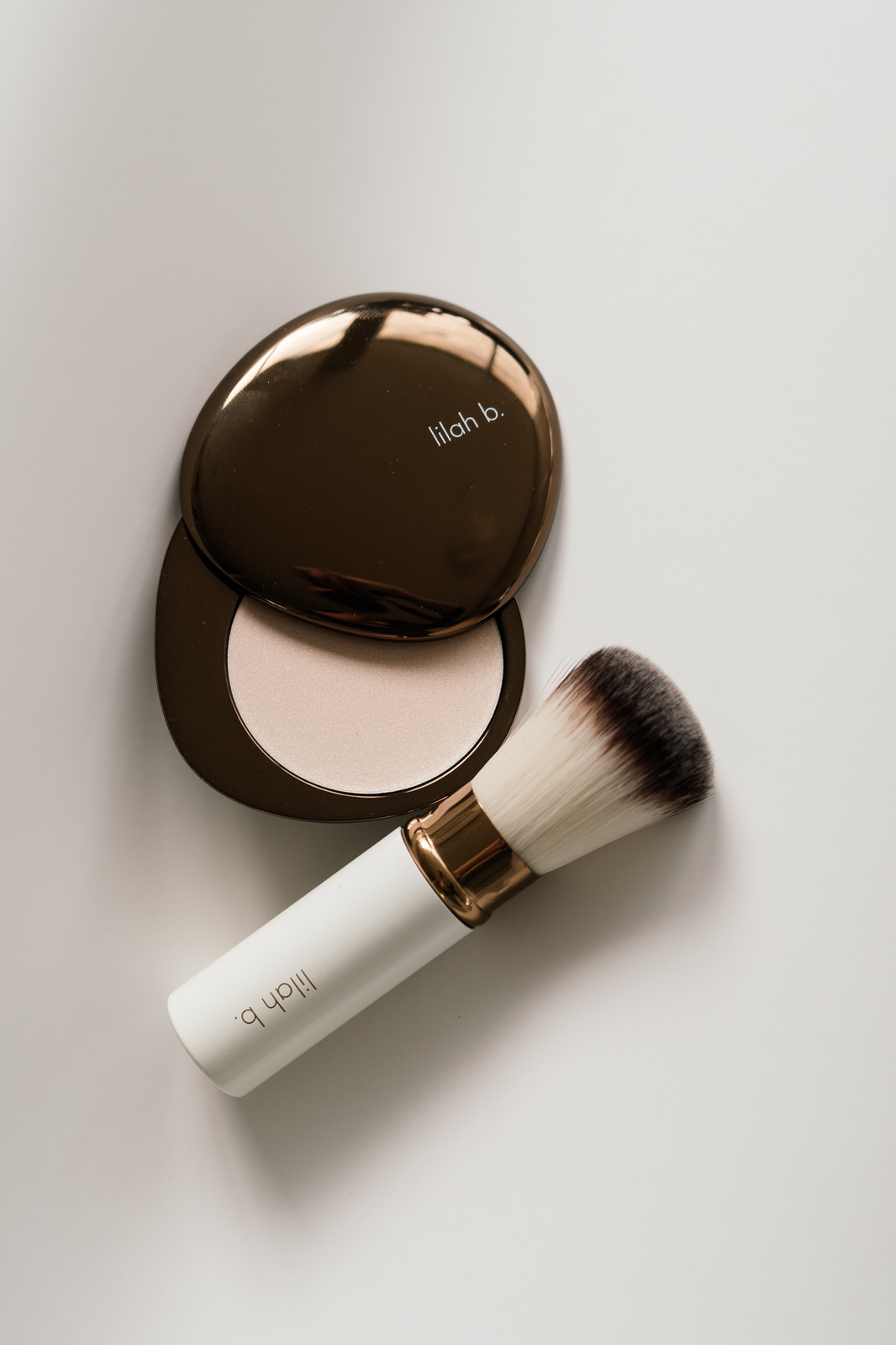 lilah b. Glisten + Glow™ Skin Illuminator and Retractable Bronzer Brush - There are so many wonderful ingredients in this range.Black Currant Seed Oil Extract and Sunflower Seed Oil, help to reduces inflammation and restores natural radiance, while Brown Sea Algae firms and hydrates to improve texture and tone.I sweep the Glisten + Glow™ Skin Illuminator along the brow bone, cheekbones and down the bridge of the nose for a shimmery finish. It is the only highlighter that is in my makeup bag right now.—I love the fluffy bristles of the vegan-friendly Retractable Bronzer Brush. It glides out smoothly of the sleek, compact case when you remove the cap. Perfect for on the go touch ups!
