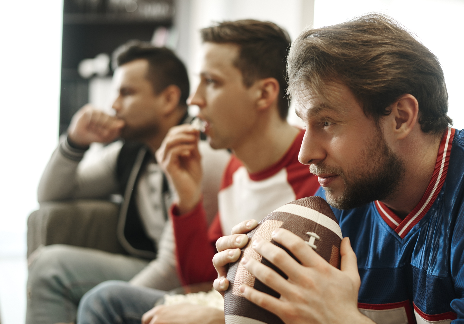 Focused-watching-football-game-at-home-910510008_2122x1416.jpeg