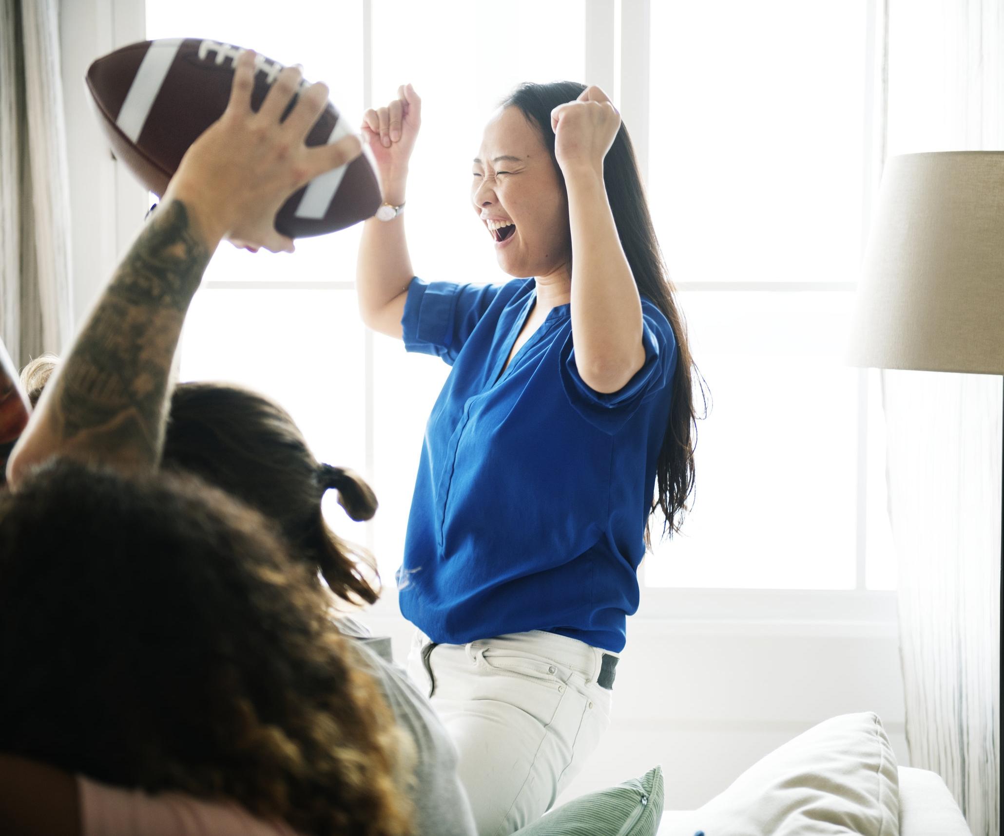 Friends-cheering-sport-league-together-923626260_7000x4821.jpeg