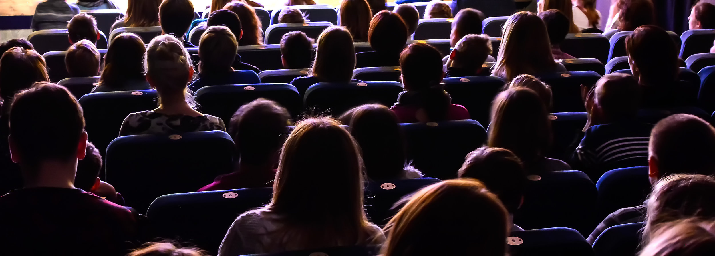 People-in-the-auditorium-watching-the-performance-886131824_4825x1732.jpeg
