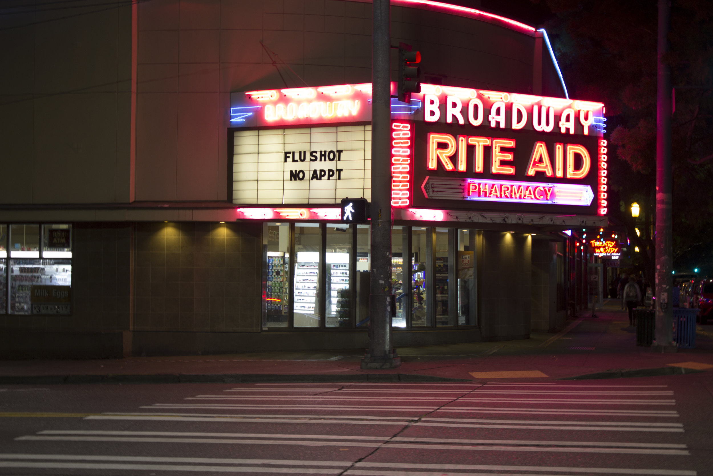 Marquee lit Rite Aid on Broadway