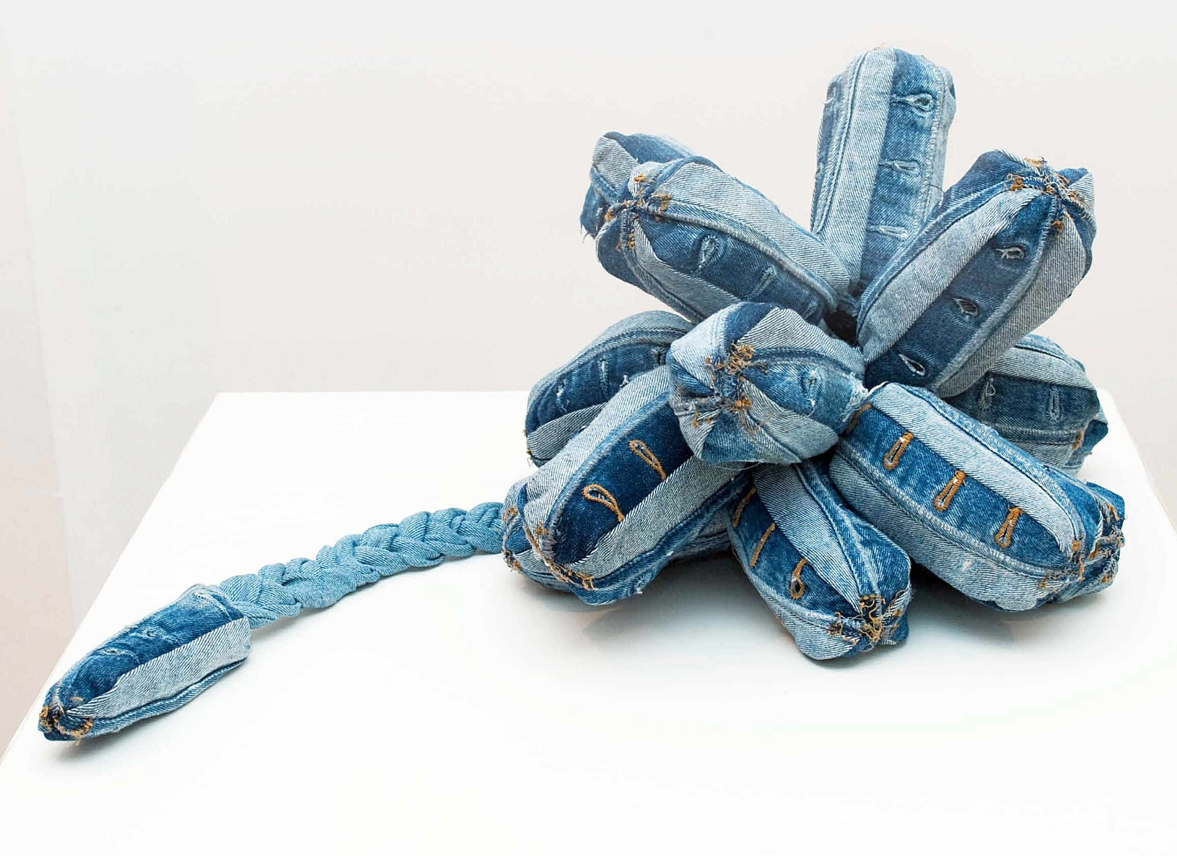"""Of Fruit and Labor, 2009   70 denim button-fly hole sections, 1 leg 14""""x30""""x16"""""""