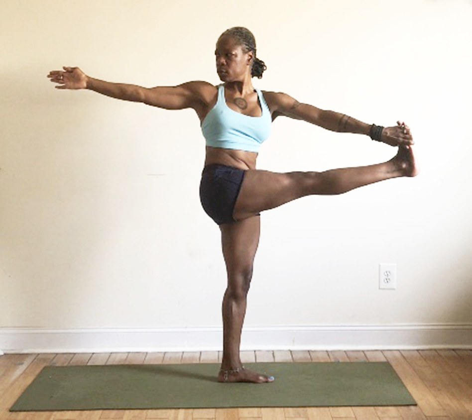parivrtta hasta padangusthasana. (standing rotated hand to foot pose)