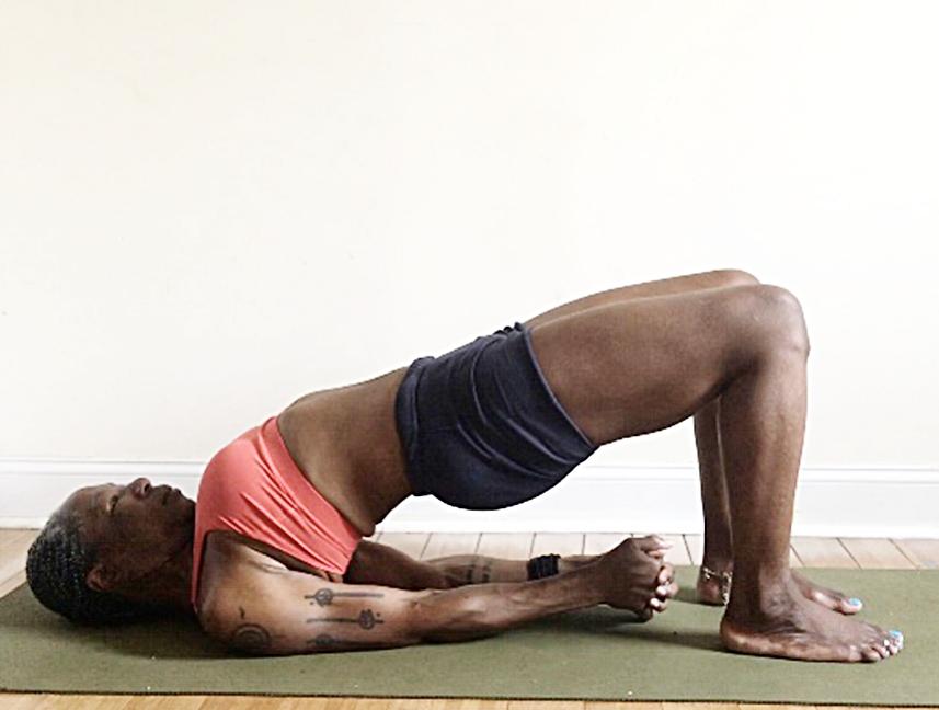 setu bandha sarvangasana. (bridge pose) feet hips distance apart. heels under knees. press into feet & shoulders, loosen glutes