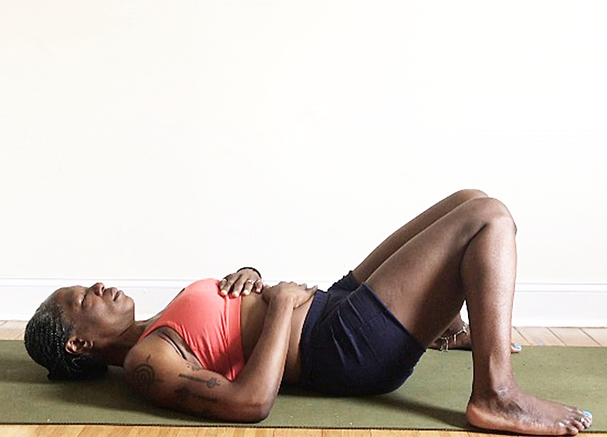 savasana.  (resting pose): constructive rest variation. feet wide as mat. knees touching.