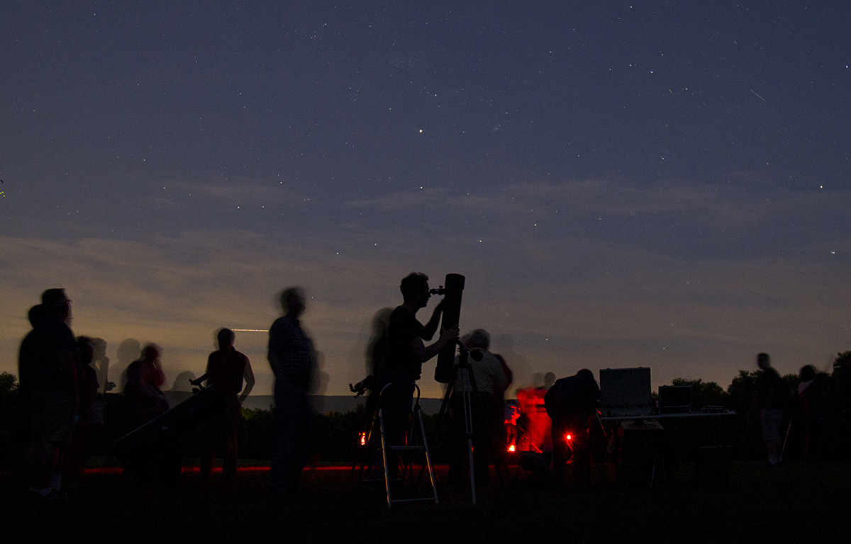 Members of the Central PA Observers Club and the State College community look at celestial bodies during a community stargazing event at Tudek Park on Friday, July 6, 2018.
