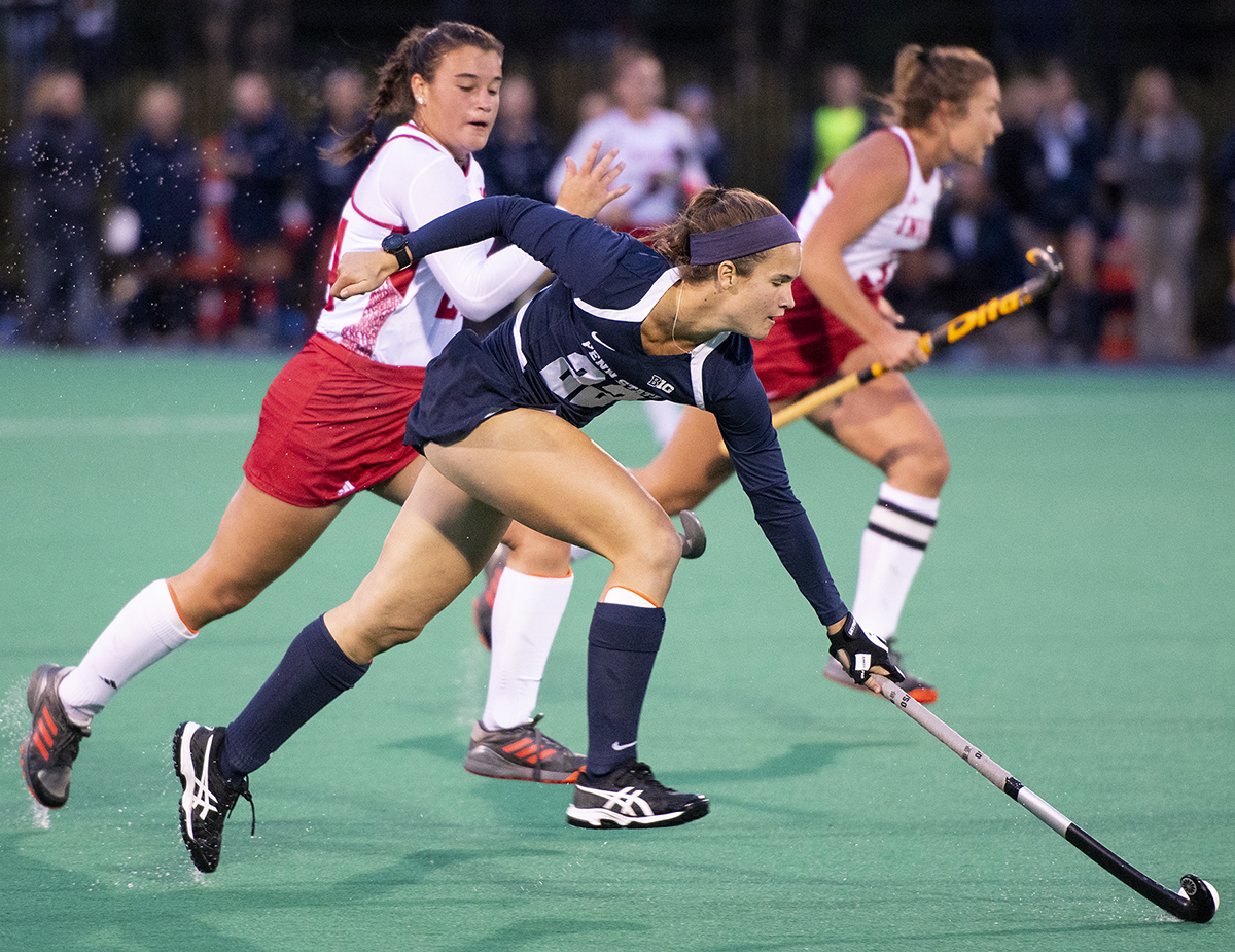 Forward Abby Myers (22) hits the ball away from midfielder Hanna Zarrilli (24) during the Penn State v. Indiana field hockey game at the Field Hockey Complex on the Penn State campus on Friday, Oct. 19, 2018. Penn State defeated Indiana 4-0.