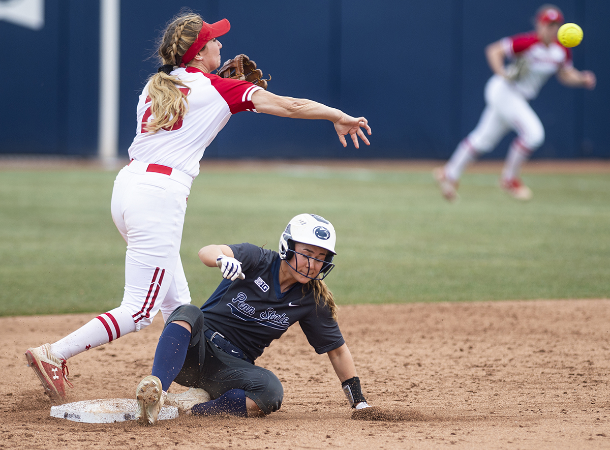 Infielder Claire Swedberg (23) slides onto second base as infielder Jordan Little (25) throws the ball during the Penn State v. Wisconsin softball game at Beard Field on Saturday, March 30, 2019. Penn State lost 3-2.