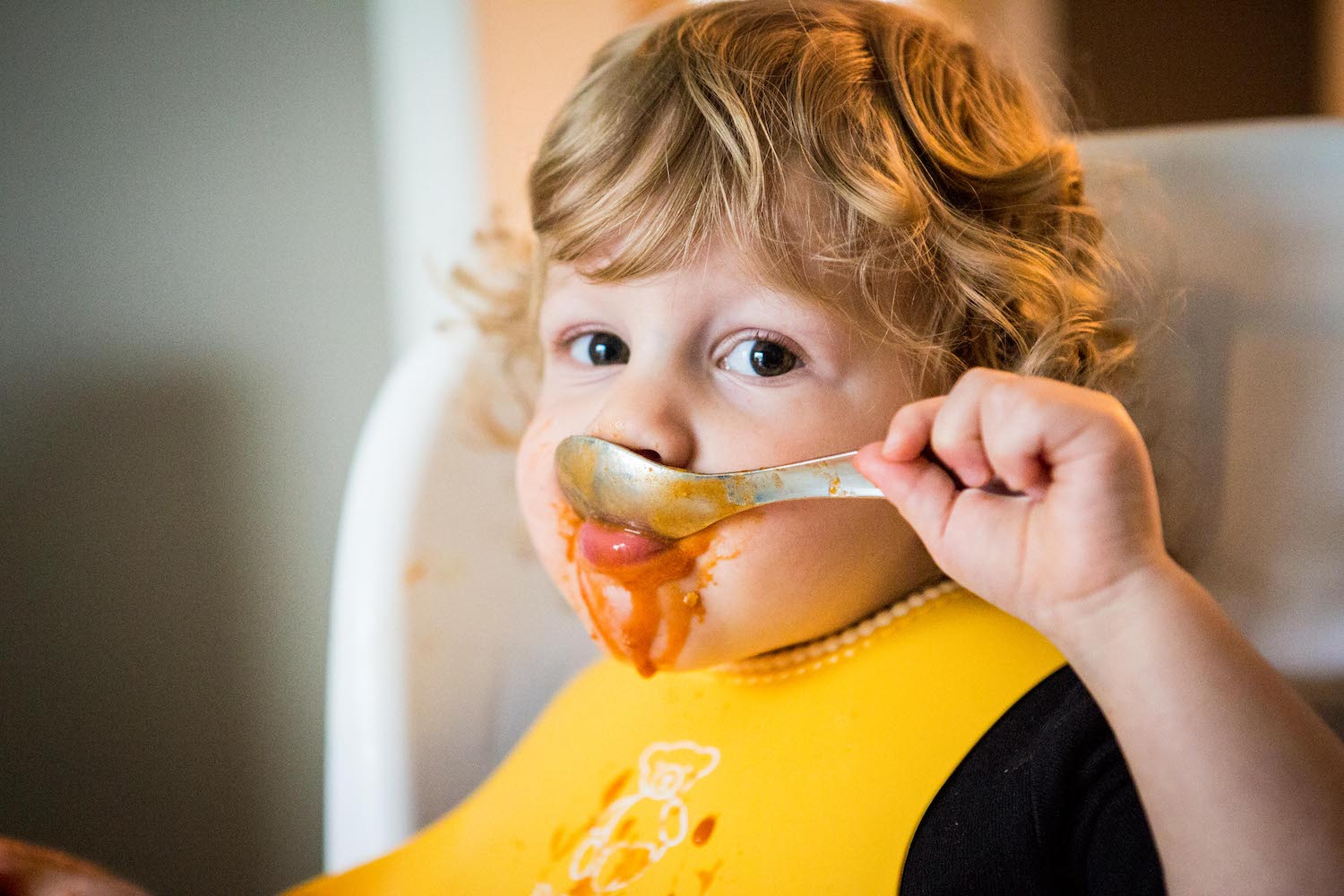 Mastering eating soup with a spoon.