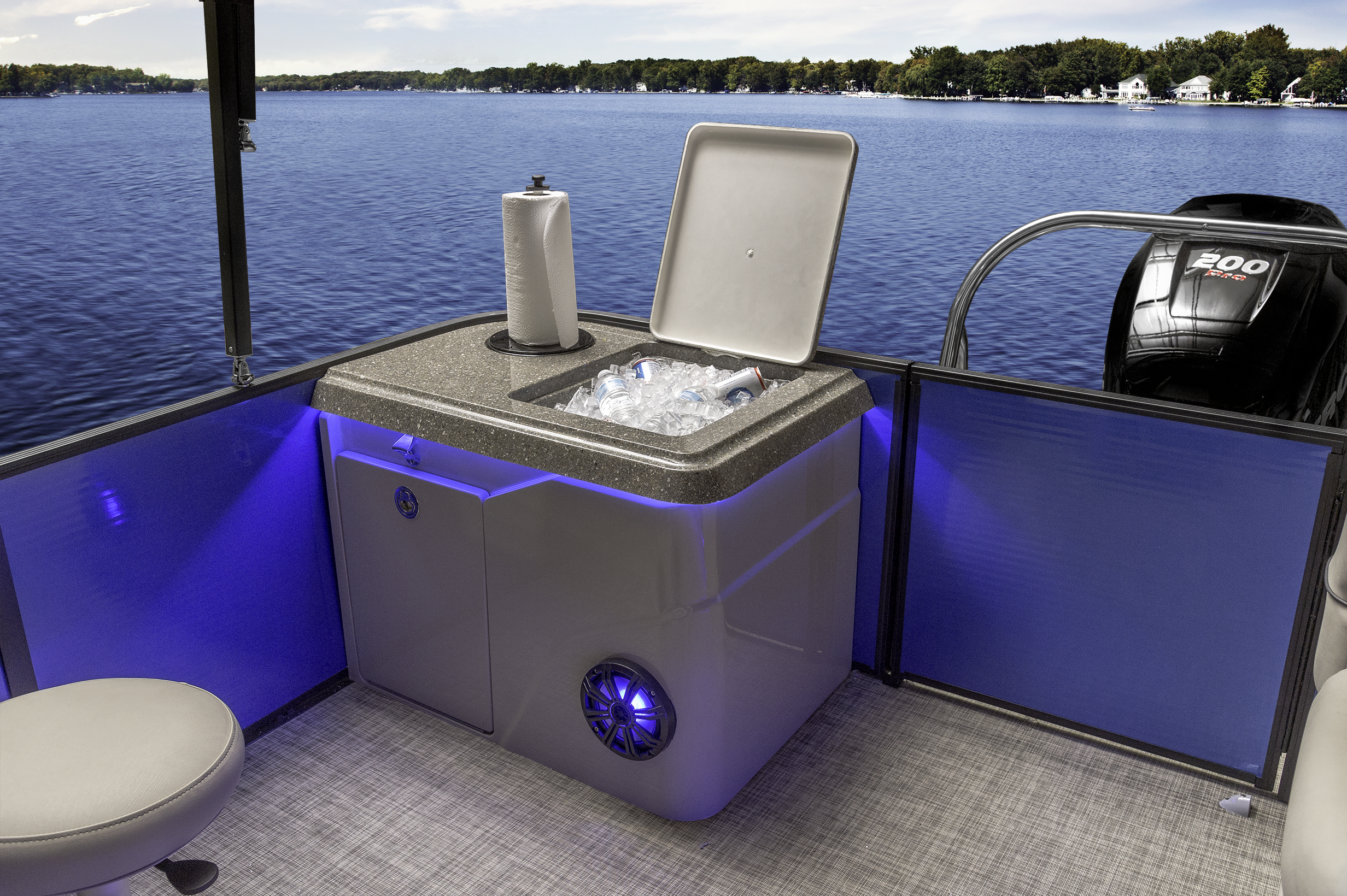 "At the rear of the bar boat sits a special storage unit.  This unit features a insulated cooler, 10"" speaker, tip out trash can, bottle opener and reversible towel holder."