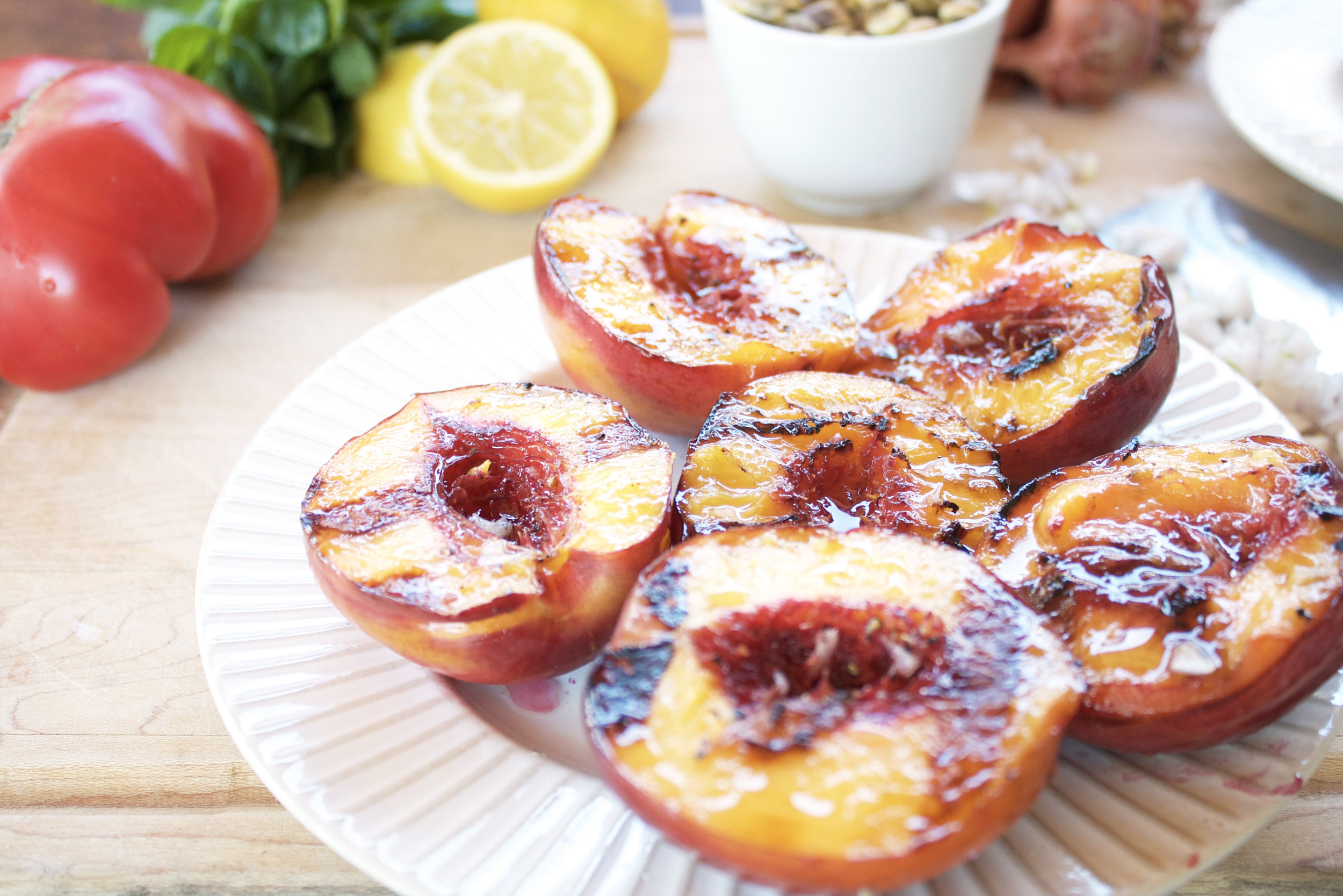 Grilled peaches for an easy summer salad by Alavita Nutrition