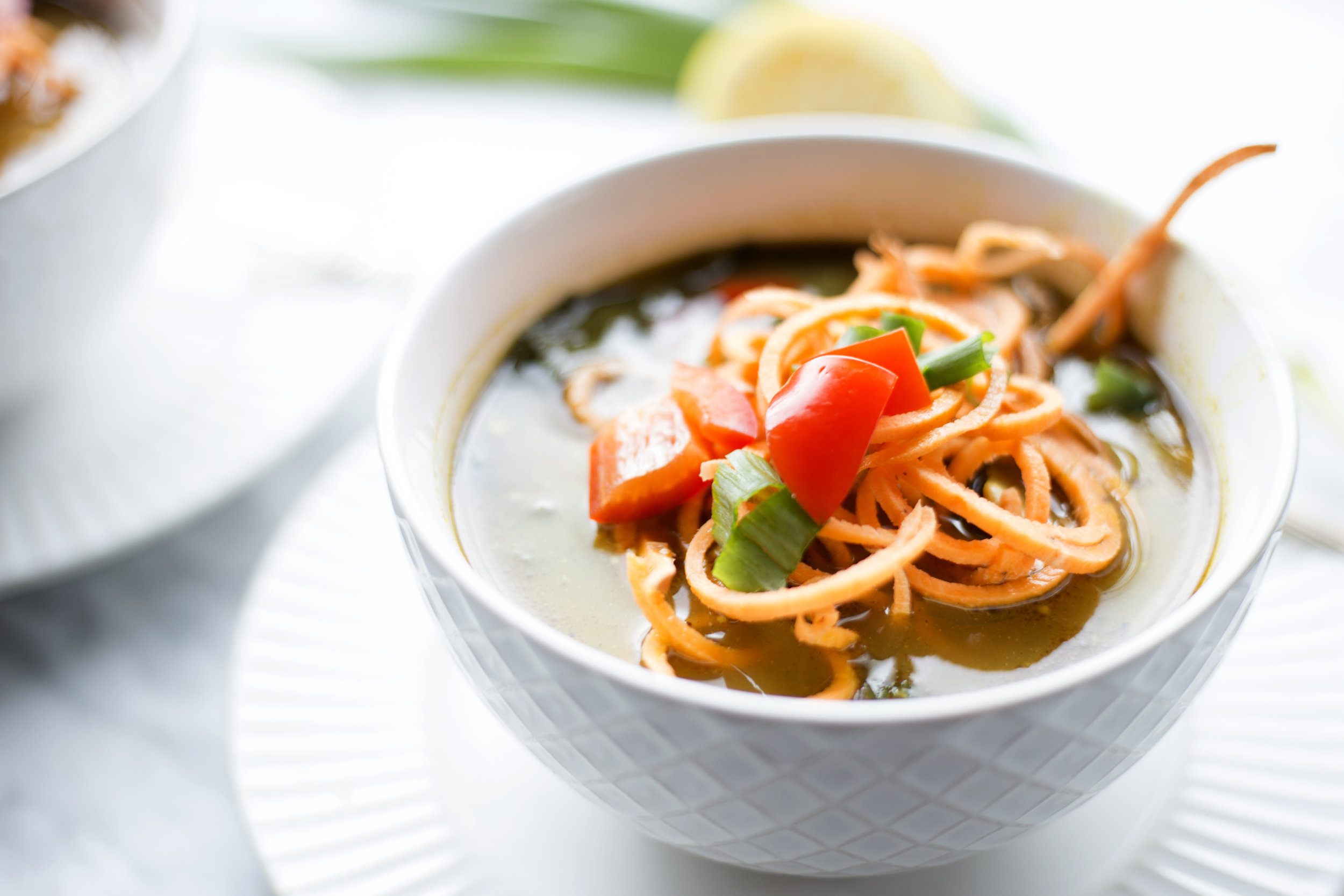 Spiralized sweet potato noodles in a fall soup