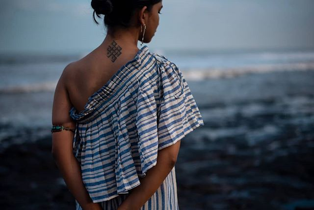 Soak up the sunshine in our shape shifting garment.☀️ Available in a delightful selection of naturally dyed fabrics. Handcrafted with care 🌿 . . . . . . . . . . . . #saynotofastfashion #buyhandmade  #handloom #tribeoftextiles #handwoven #tailormade #ethicalfashion #buylocal #sustainablefashion #summerdress #resortwear #consciousfashion #makersmovement #handmadefashion #pleated #villagesnotfactories #taintedmag #somewheremagazine #chasinglight #independentmag #buylesschoosewell #slowfashionmovement #ethicalootd