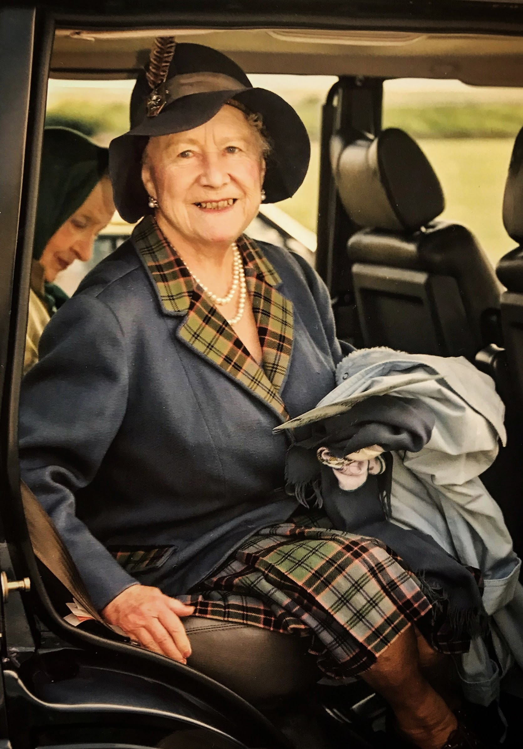 This was taken whilst the Queen Mother was on holiday at the Castle of Mey in August, 1992. She had turned up to watch the local sheep dog trials and support the event. As ever she was a dream to photograph, turning in her car seat to ensure l got the shot. She had a wonderful knack of making you feel very special and each time I was lucky enough to meet her, she was effortlessly charming. Photographer: David Butler