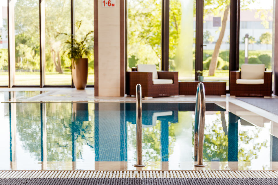 grab-bars-ladder-in-the-blue-swimming-pool-P8T5L4X.jpg