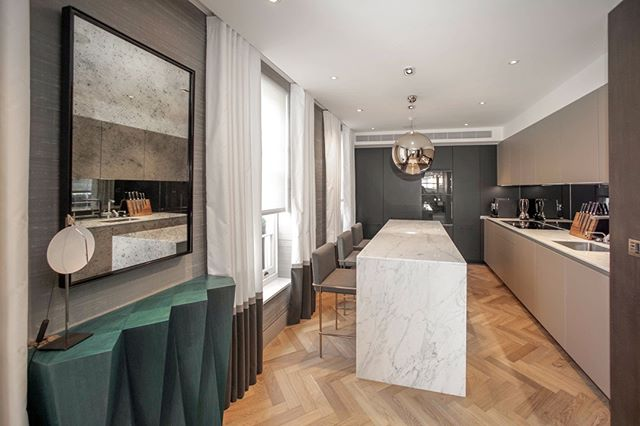 We love the combination of materials for this bespoke kitchen, central island and side table designed by ourselves. We were appointed to carry out a whole flat redesign and fit out. Everything you see we either designed / manufactured or specified. (3/3) . . . #inside #contemporary #apartment #indoors #family #house #room #interiordesign #design #modern #furniture #luxury #wall #wood #window #londonarchitecture #architecture #flooring #joinery #archilovers #livingroom #bespoke #apartment #interiors #kitchen
