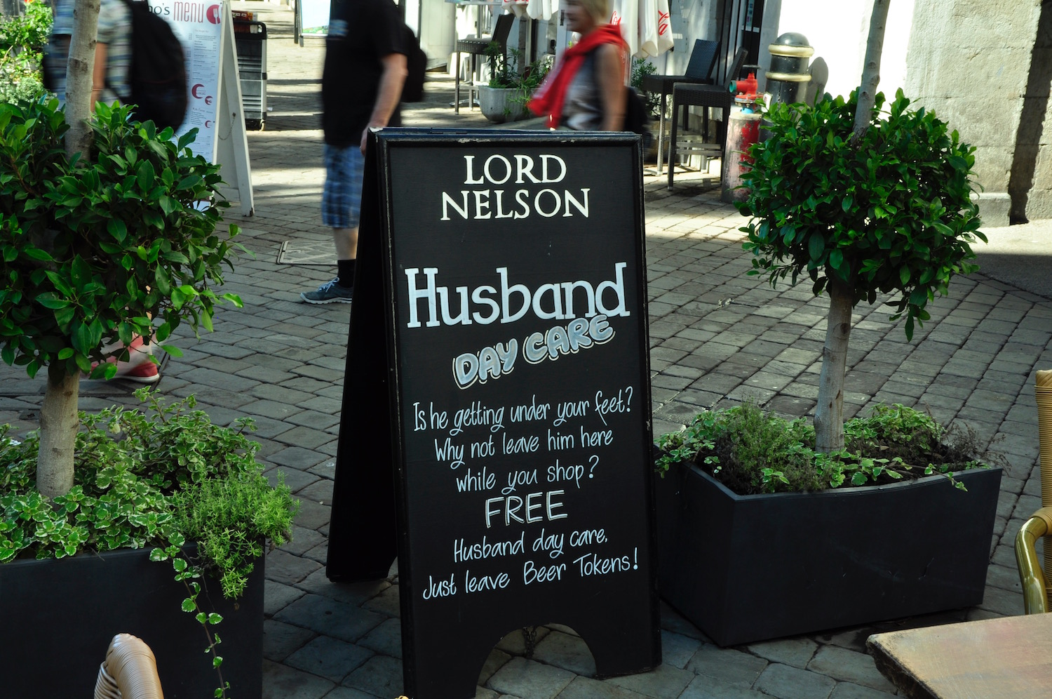 Lord Nelson Pub - Tucked away in a sunny corner of Casemates, this English sports bar is run by the Rock's biggest restaurant family. Good pub grub and - as you'll see from the sign - daddy day care!