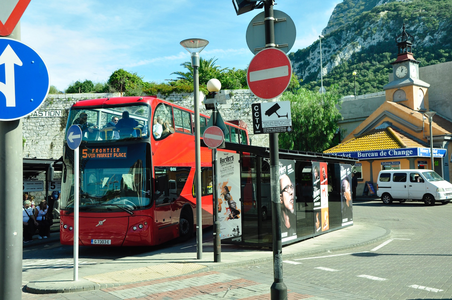 Hop on a red double decker from the border to Market Place/Grand Casemates Sq.